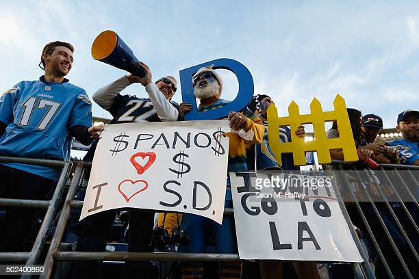 San Diego Chargers fans hold signs supporting the San Diego Chargers during a game against the Miami Dolphins at Qualcomm Stadium on December 20 2015...