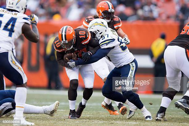 San Diego Chargers Linebacker Jatavis Brown tackles Cleveland Browns Quarterback Robert Griffin III during the second quarter of the National...