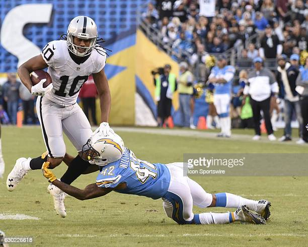 San Diego Chargers Long Snaper Mike Windt tackles Oakland Raiders Wide Receiver Seth Roberts during the NFL football game between the Oakland Raiders...