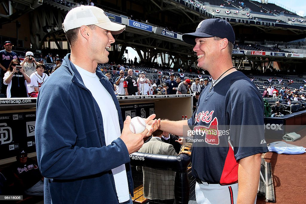 San Diego Chargers quarterback Philip Rivers greets Chipper Jones of the Atlanta Braves before the San Diego Padres home opener on April 12 2010 at...