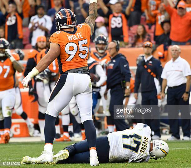 San Diego Chargers quarterback Philip Rivers lays on the ground after getting hit by Denver Broncos defensive end Derek Wolfe on 4th down during the...