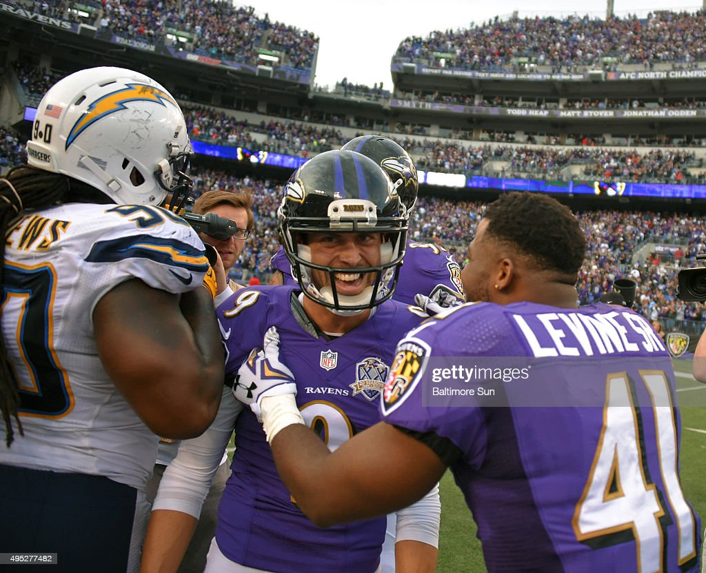 San Diego Chargers' Ricardo Mathews heads off the field as Baltimore Ravens' Anthony Levine congratulates kicker Justin Tucker as he reacts to...