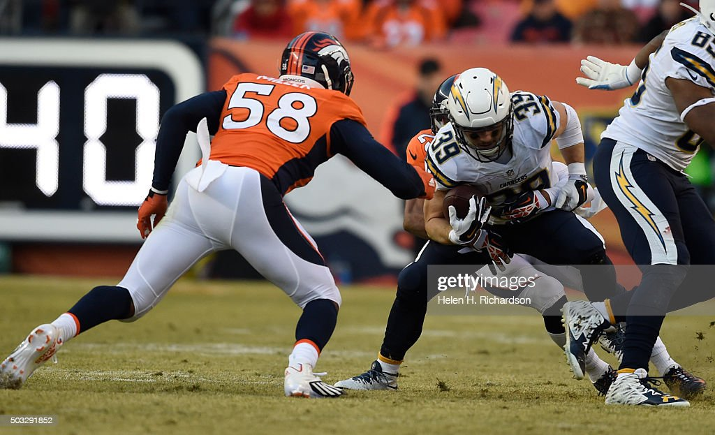 San Diego Chargers running back <a gi-track='captionPersonalityLinkClicked' href=/galleries/search?phrase=Danny+Woodhead&family=editorial&specificpeople=4536267 ng-click='$event.stopPropagation()'>Danny Woodhead</a> (39) gets tackled by Denver Broncos cornerback <a gi-track='captionPersonalityLinkClicked' href=/galleries/search?phrase=Chris+Harris+-+American+Football+Cornerback&family=editorial&specificpeople=15029474 ng-click='$event.stopPropagation()'>Chris Harris</a> (25) as Denver Broncos outside linebacker <a gi-track='captionPersonalityLinkClicked' href=/galleries/search?phrase=Von+Miller&family=editorial&specificpeople=7125735 ng-click='$event.stopPropagation()'>Von Miller</a> (58) moves in during the second quarter January 3, 2016 at Sports Authority Field at Mile High Stadium.