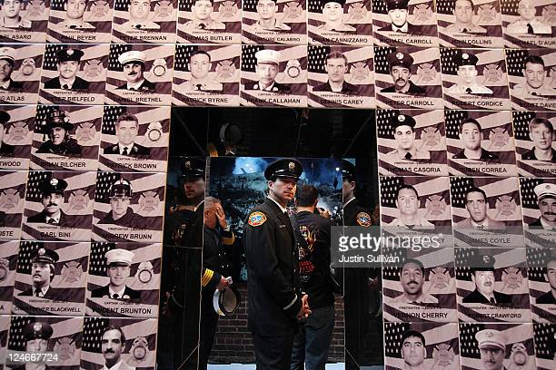 San Diego City firefighter William McLaughlin pauses as he looks at a memorial for the 343 New York firefighters who died during the September 11...