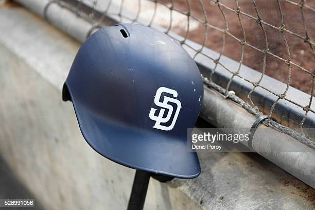 San Diego Padres batting helmet sits in the dugout before a baseball game between the San Diego Padres and the Colorado Rockies at PETCO Park on May...