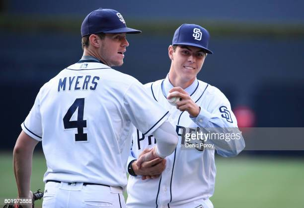 San Diego Padres draft pick MacKenzie Gore right shakes hands with Wil Myers after throwing out the first pitch before a baseball game between the...