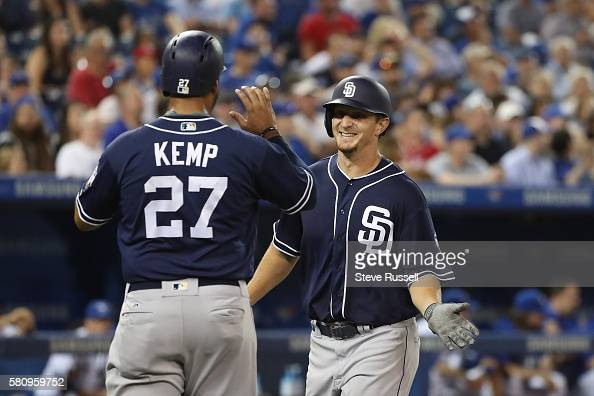 TORONTO ON JULY 25 San Diego Padres left fielder Alex Dickerson celebrates a two run homer into the fifth deck as the Toronto Blue Jays beat the San...