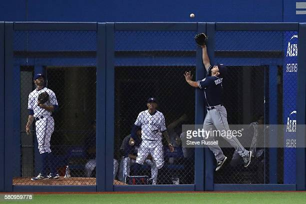 TORONTO ON JULY 25 San Diego Padres left fielder Alex Dickerson fails to catch this Troy Tulowitzki double as the Toronto Blue Jays beat the San...