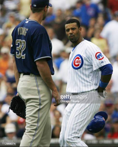 San Diego Padres pitcher Chris Young left has words with Chicago Cubs' Derrek Lee after Lee was hit in the wrist by a pitch in the bottom of the...