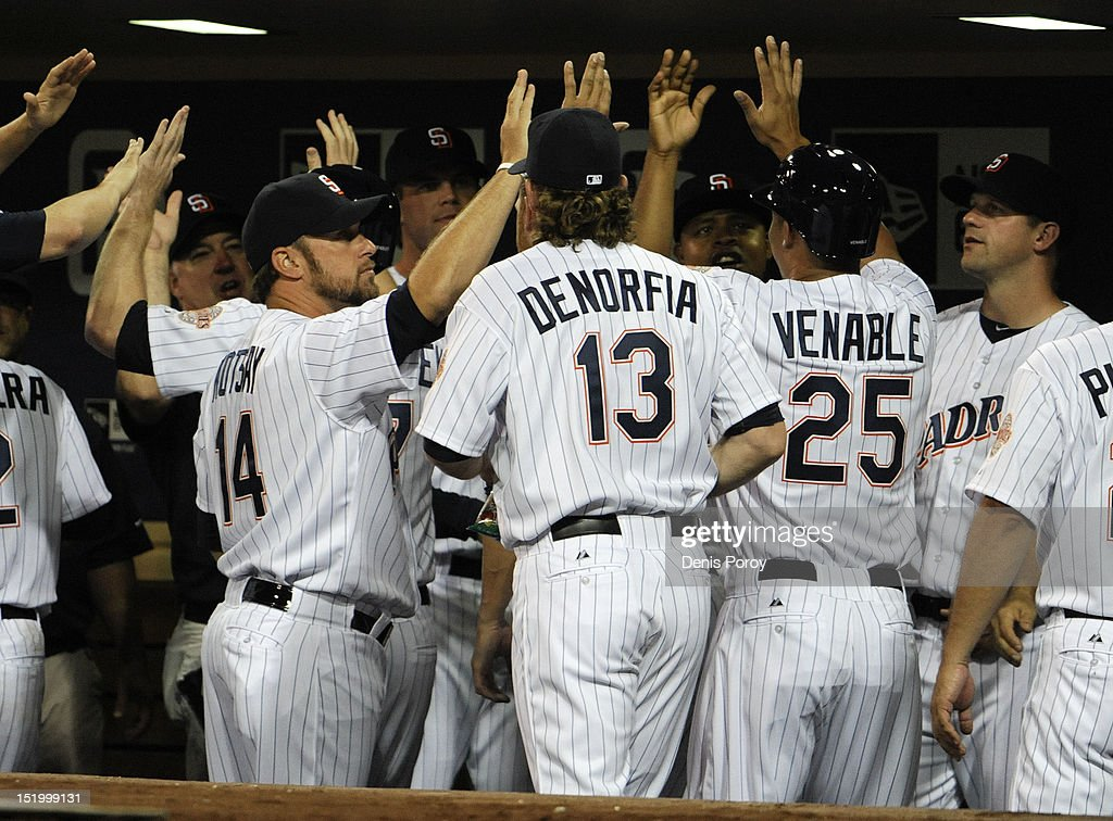 San Diego Padres players celebrate after Yonder Alonso #23 hit a grand slam during the first inning of a baseball game against the Colorado Rockies at Petco Park on September 14, 2012 in San Diego, California.
