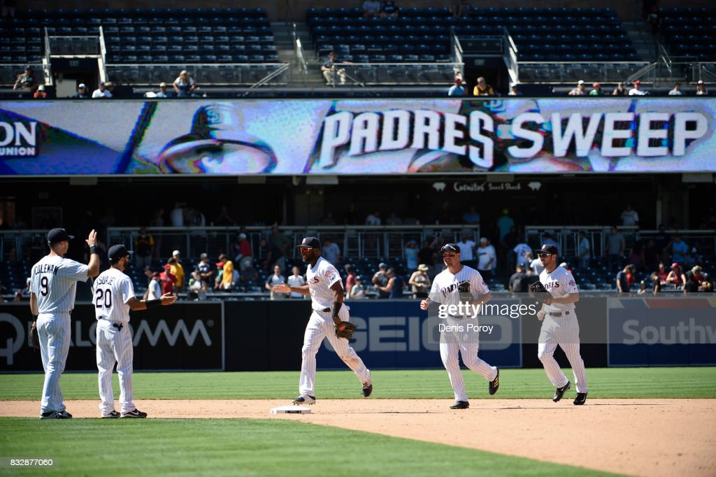 San Diego Padres players high five after beating the Philadelphia Phillies 3-0 in a baseball game at PETCO Park on August 16, 2017 in San Diego, California.