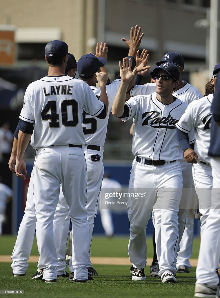 San Diego Padres players high five after beating the San Francisco Giants 4-1 in a baseball game at Petco Park on September 2, 2013 in San Diego, California.