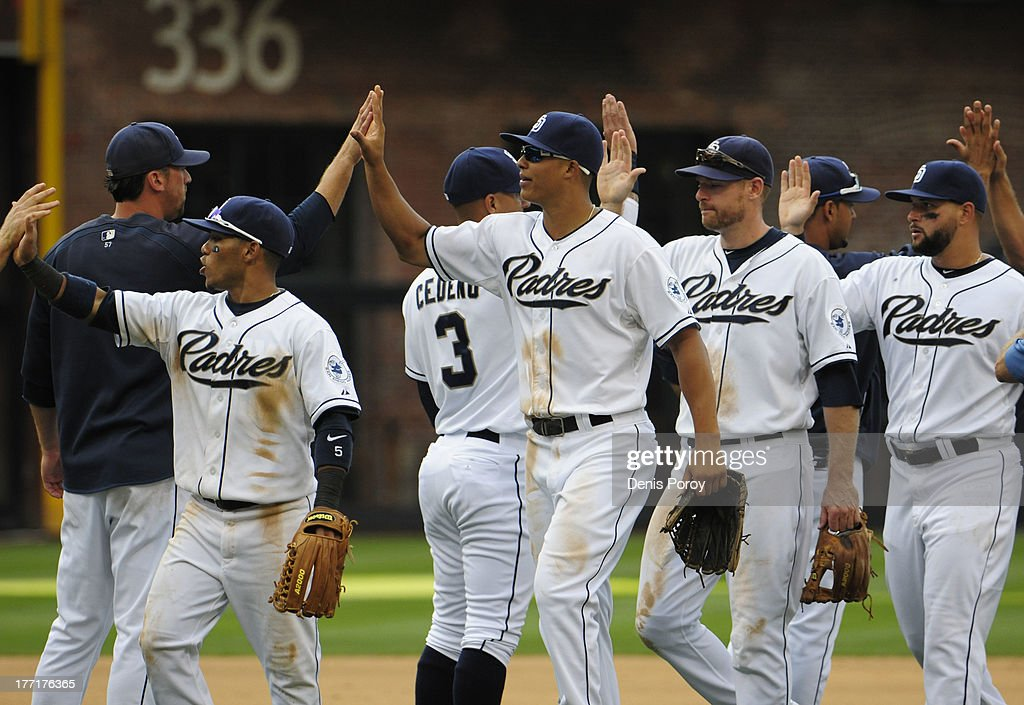 San Diego Padres players high-five after beating Pittsburgh Pirates 2-1 in a baseball game at Petco Park on August 21, 2013 in San Diego, California. .