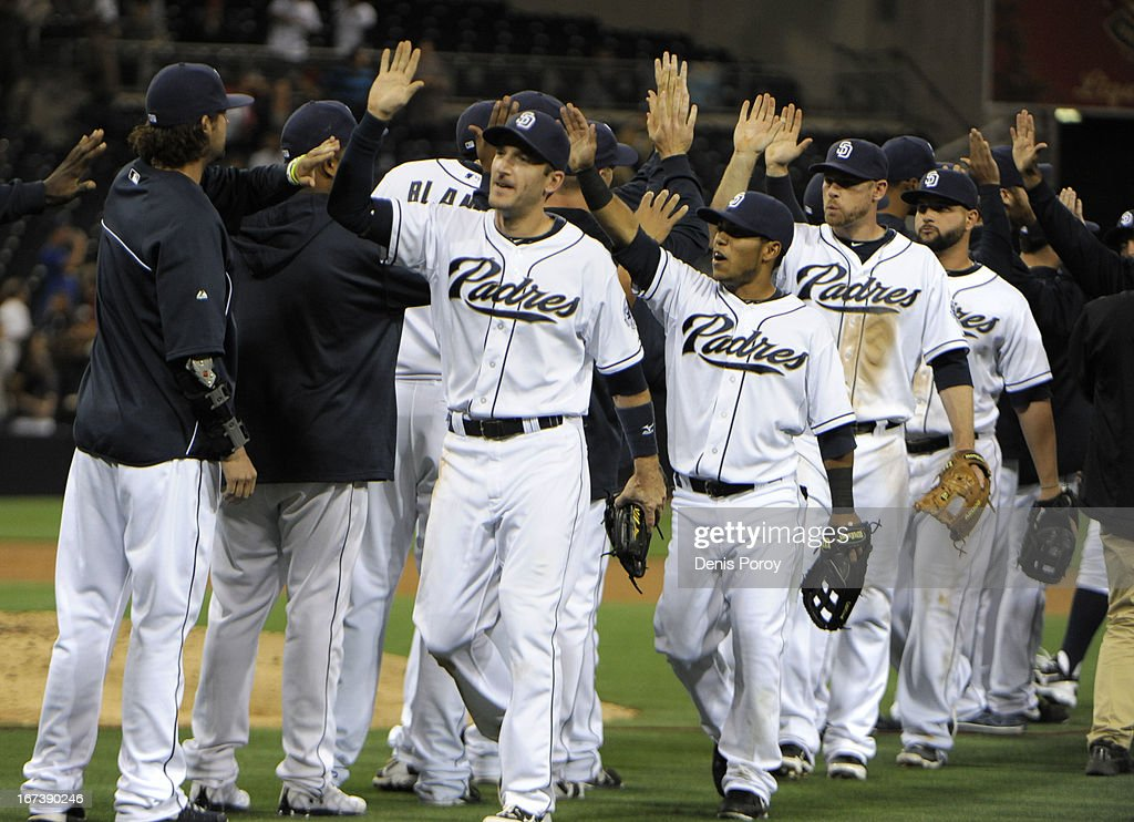San Diego Padres players high-five after beating the Milwaukee Brewers 2-1 in a baseball game at Petco Park on April 24, 2013 in San Diego, California. The Padres won 2-1.