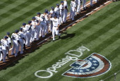 San Diego Padres players highfive during pregame festivities on Opening Day before a baseball game between the Los Angeles Dodgers and the San Diego...