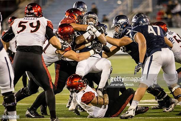 San Diego players stop another run by Reno tonight at Mackay Stadium on November 12 2016 in Reno Nevada