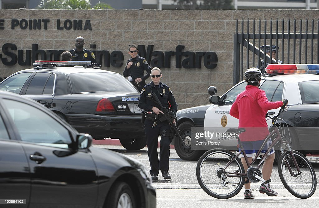 San Diego Police officers lock down Naval Base Point Loma as police search for suspect, former LAPD officer Christopher Jordan Dorner, February 7, 2013 in San Diego, California. A manhunt is underway for Dorner, who is suspected of shooting at police officers in the Southern California area.