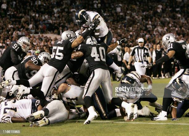 San Diego runningback LaDainian Tomlinson goes up high for the first touchdown of the game as the San Diego Chargers defeated the Oakland Raiders by...