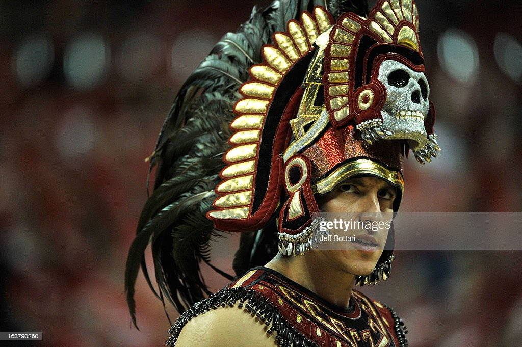San Diego State Aztecs mascot Aztec Warrior appears on the court during the first half of a semifinal game of the Reese's Mountain West Conference Basketball tournament against the New Mexico Lobos at the Thomas & Mack Center on March 15, 2013 in Las Vegas, Nevada. New Mexico won 60-50.