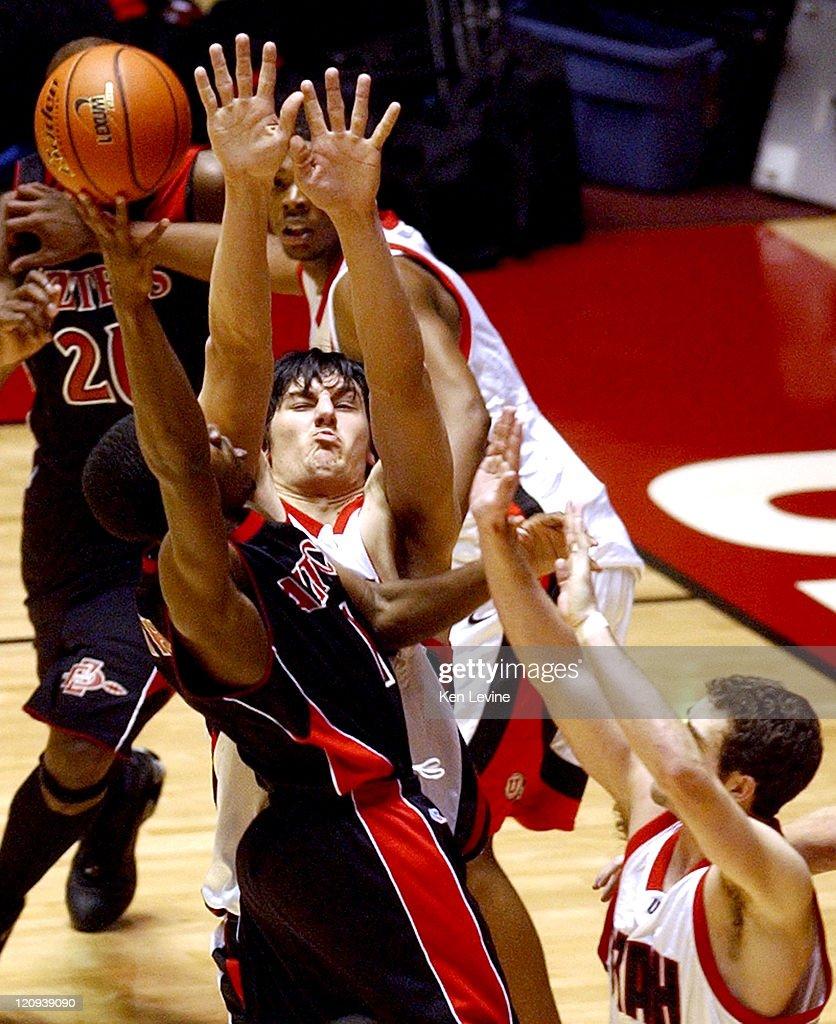 San Diego State guard Brandon Heath (1) shoots over Utah center Andrew Bogut (4) and guard Marc Jackson (2). Utah defeated San Diego State 72-60 at the Jon Huntsman Center in Salt Lake City, Utah, on March 5, 2005.