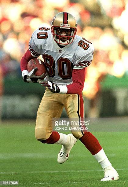 San Francisco 49ers AllPro widereceiver Jerry Rice runs down field after catching a pass from 49ers quarterback Steve Young during an exhibition game...