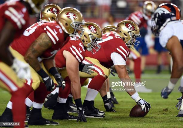 San Francisco 49ers Center Tim Barnes prepares to snap the ball at the line of scrimmage during an NFL preseason game between the Denver Broncos and...