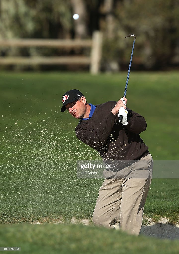 San Francisco 49ers coach Jim Harbaugh plays a bunker shot on the second hole during the final round of the AT&T Pebble Beach National Pro-Am at Pebble Beach Golf Links on February 10, 2013 in Pebble Beach, California.