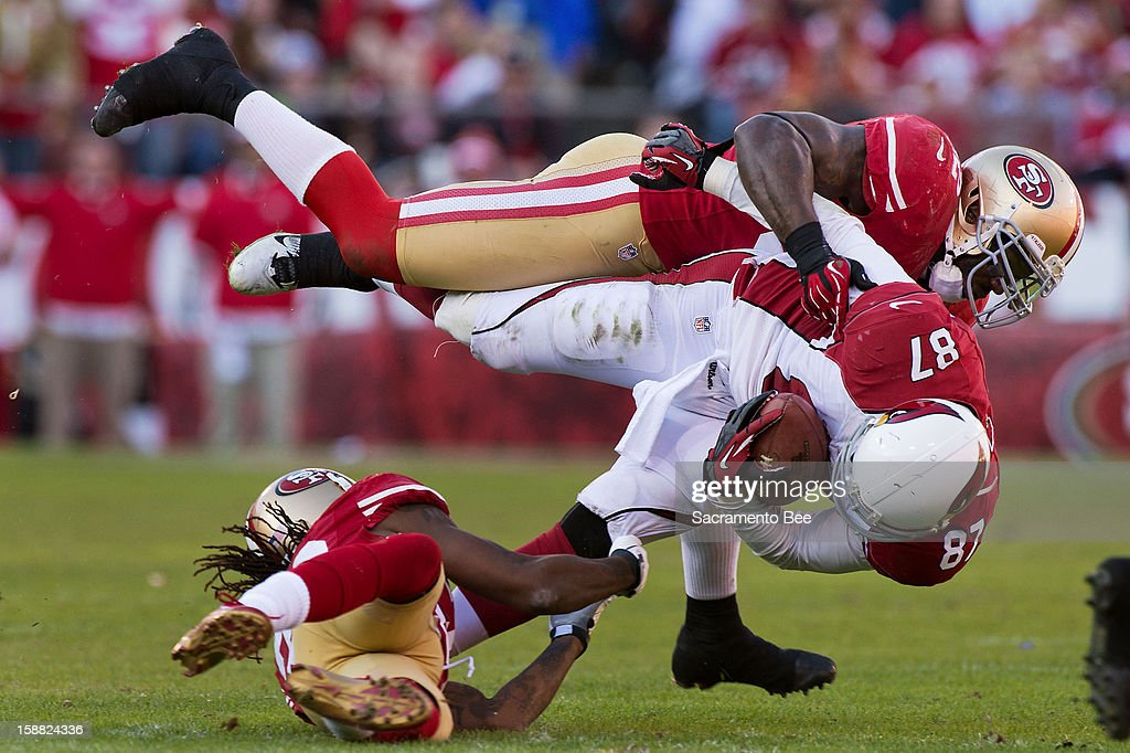 San Francisco 49ers cornerback Tarell Brown (25) tackles Arizona Cardinals' tight end Jeff King (87) at Candlestick Park in San Francisco, California on Sunday, December 30, 2012. The San Francisco 49ers defeated the Arizona Cardinals, 27-13.