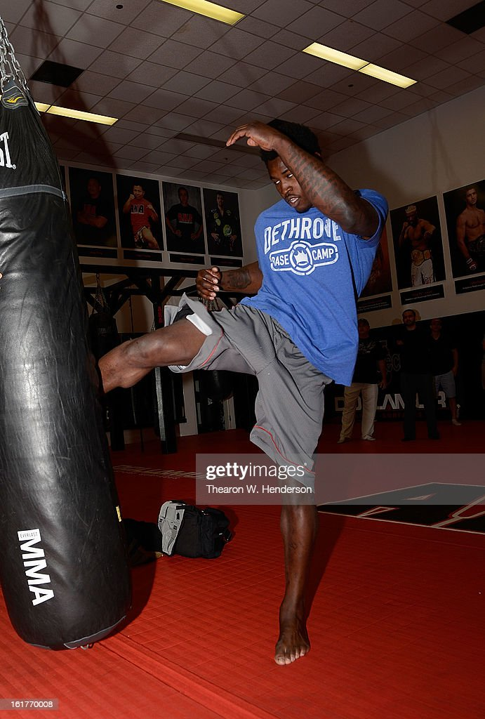 San Francisco 49ers defensive end Aldon Smith kicking a heavy bag while working out with UFC Heavyweight fighter Daniel Cormier at AKA San Jose on February 15, 2013 in San Jose, California.