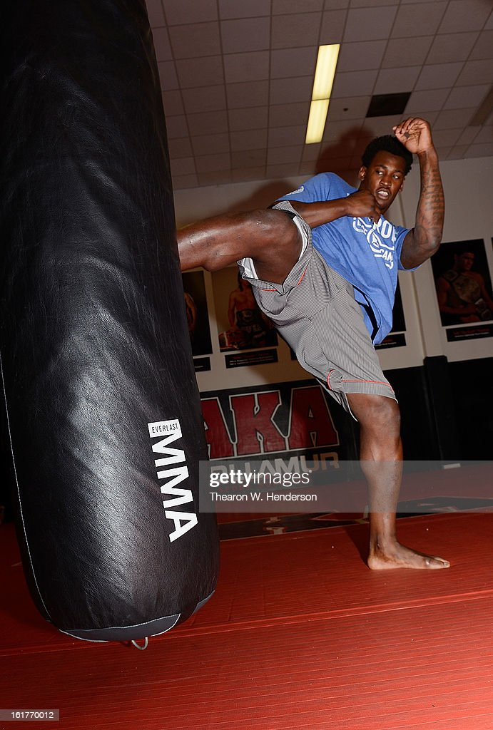 San Francisco 49ers defensive end Aldon Smith kicks a heavy bag while working out with UFC Heavyweight fighter Daniel Cormier at AKA San Jose on February 15, 2013 in San Jose, California.