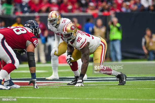 San Francisco 49ers defensive end Tank Carradine gets ready for a play during the football game between the San Francisco 49ers and the Houston...