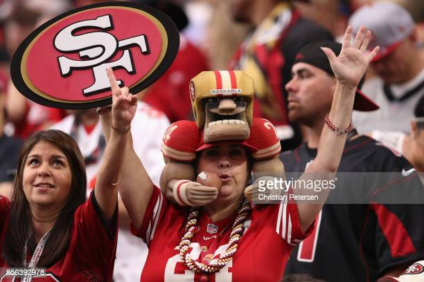 San Francisco 49ers fan cheers during the first half of the NFL game against the Arizona Cardinals at the University of Phoenix Stadium on October 1...