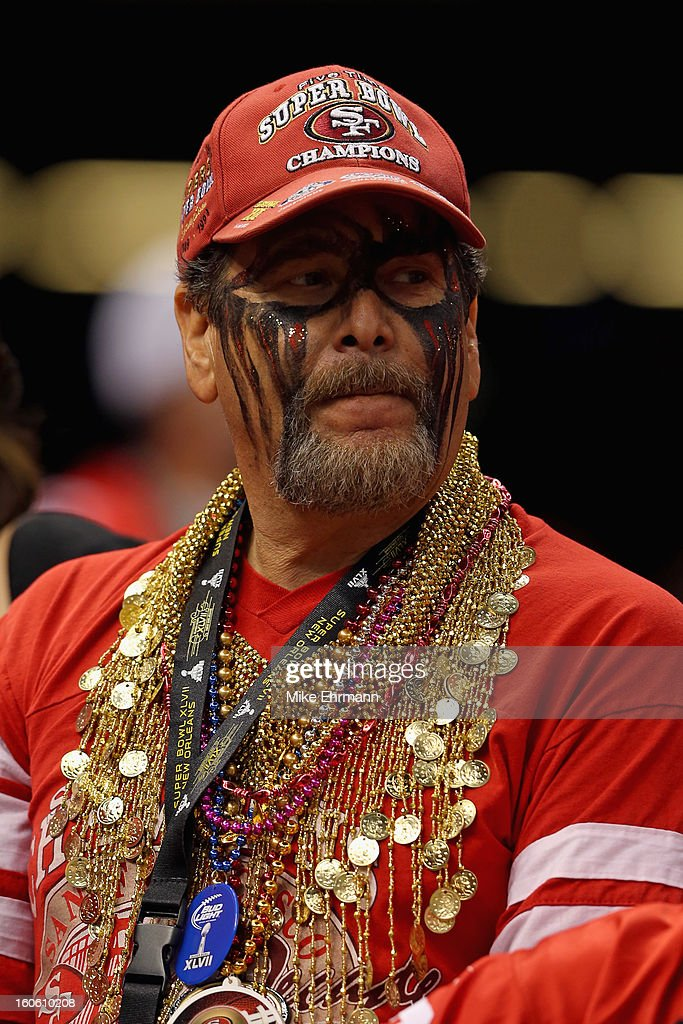 A San Francisco 49ers fan watches pregame warm ups prior to Super Bowl XLVII against the Baltimore Ravens at the Mercedes-Benz Superdome on February 3, 2013 in New Orleans, Louisiana.