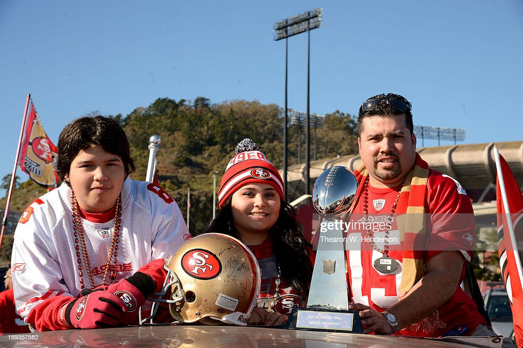 San Francisco 49ers fans Ruben Reyes, Cassandra Marie Reyes and Jose Reyes of San Francisco, California pose prior to the NFC Divisional Playoff Game between the Green Bay Packers and the San Francisco 49ers at Candlestick Park on January 12, 2013 in San Francisco, California.