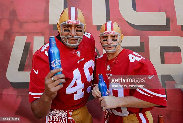 San Francisco 49ers fans 'The Helmet Heads' Paul Maldonado and Marcus Sperry from Sacramento Ca enjoys a beer prior to the start of an NFL football...