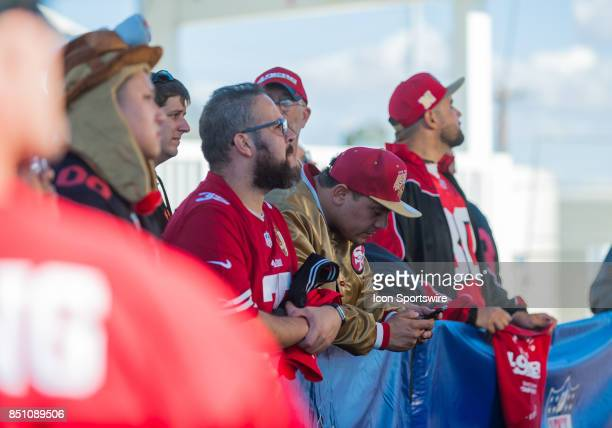 San Francisco 49ers fans wait outside at a TV set up outside the stadium before the regular season game between the San Francisco 49ers and the Los...