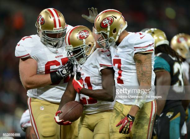 San Francisco 49ers' Frank Gore celebrates with team mates Daniel Kilgore and Colin Kaepernick after scoring a touchdown during the NFL International...