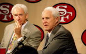San Francisco 49ers head coach George Seifert listens as new assistant coach Bill Walsh responds to questions during a press conference in Santa...