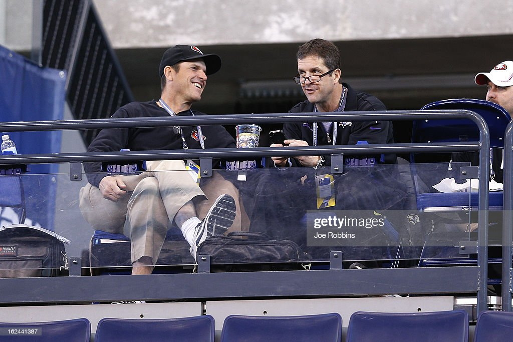 San Francisco 49ers head coach Jim Harbaugh (left) and Baltimore Ravens head coach John Harbaugh (right) look on during the 2013 NFL Combine at Lucas Oil Stadium on February 23, 2013 in Indianapolis, Indiana.