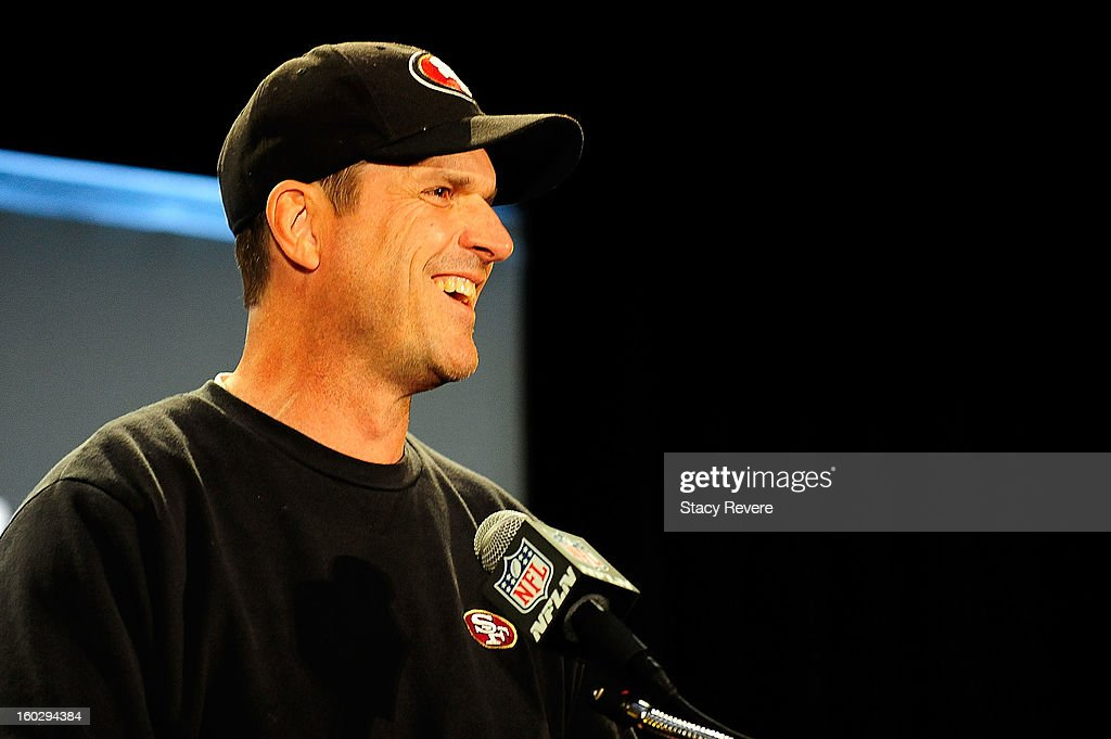 San Francisco 49ers head coach, Jim Harbaugh, speaks with the media during a media availability session for Super Bowl XLVII at the New Orleans Marriot on January 28, 2013 in New Orleans, Louisiana.