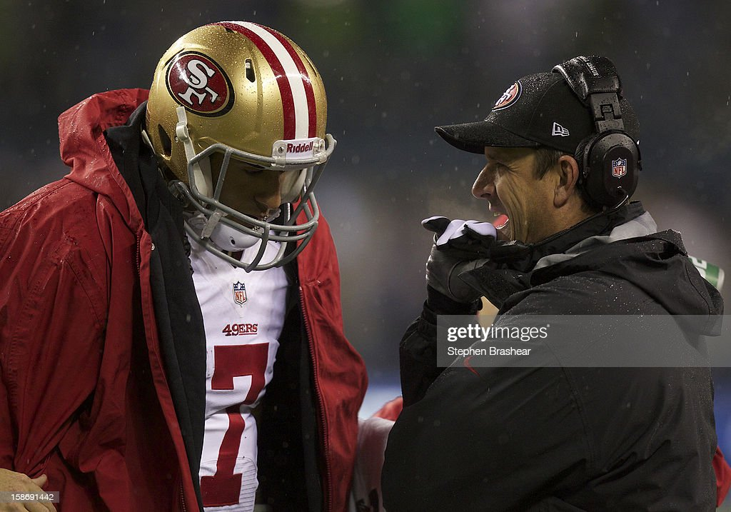 San Francisco 49ers head coach <a gi-track='captionPersonalityLinkClicked' href=/galleries/search?phrase=John+Harbaugh&family=editorial&specificpeople=763525 ng-click='$event.stopPropagation()'>John Harbaugh</a> talks with <a gi-track='captionPersonalityLinkClicked' href=/galleries/search?phrase=Colin+Kaepernick&family=editorial&specificpeople=5525694 ng-click='$event.stopPropagation()'>Colin Kaepernick</a> #7 on the sideline of a game against the Seattle Seahawks at CenturyLink Field on December 23, 2012 in Seattle, Washington.