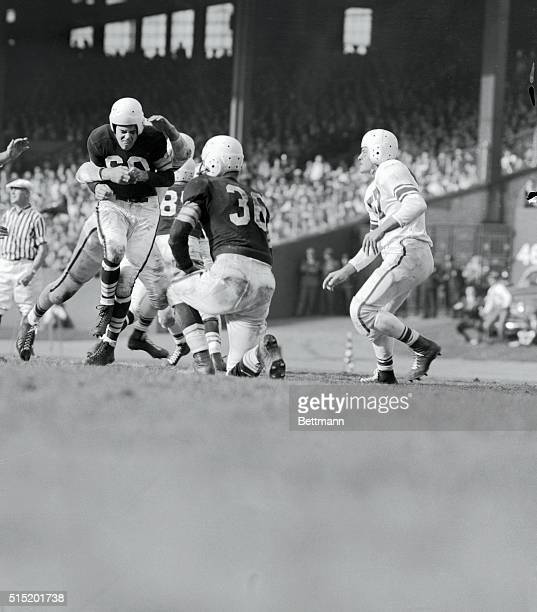 San Francisco 49ers' hit Otto Graham after a second period incomplete pass in game with Cleveland Browns in Municipal Stadium here today 10/27 It was...