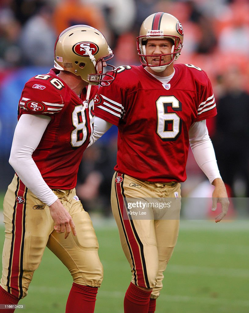 San Francisco 49ers kicker Joe Nedney is congratulated by Brian Jennings after kicking a 52yard field goal in the third quarter of 246 loss to the...