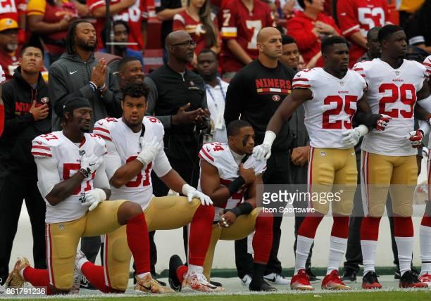 San Francisco 49ers linebacker Eli Harold defensive end Arik Armstead and cornerback K'Waun Williams kneel during the National Anthem prior to a...