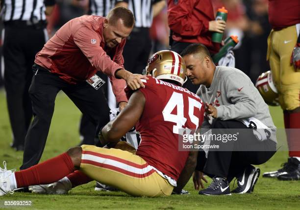 San Francisco 49ers Linebacker Pita Taumoepenu is assessed by the medical staff after being injured during an NFL preseason game between the Denver...