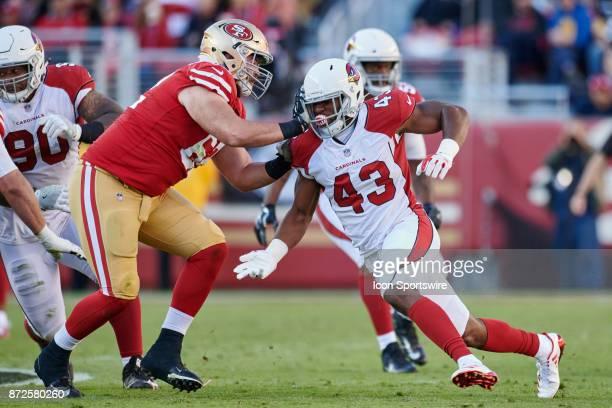 San Francisco 49ers offensive tackle Erik Magnuson battles with Arizona Cardinals inside linebacker Haason Reddick during an NFL game between the...