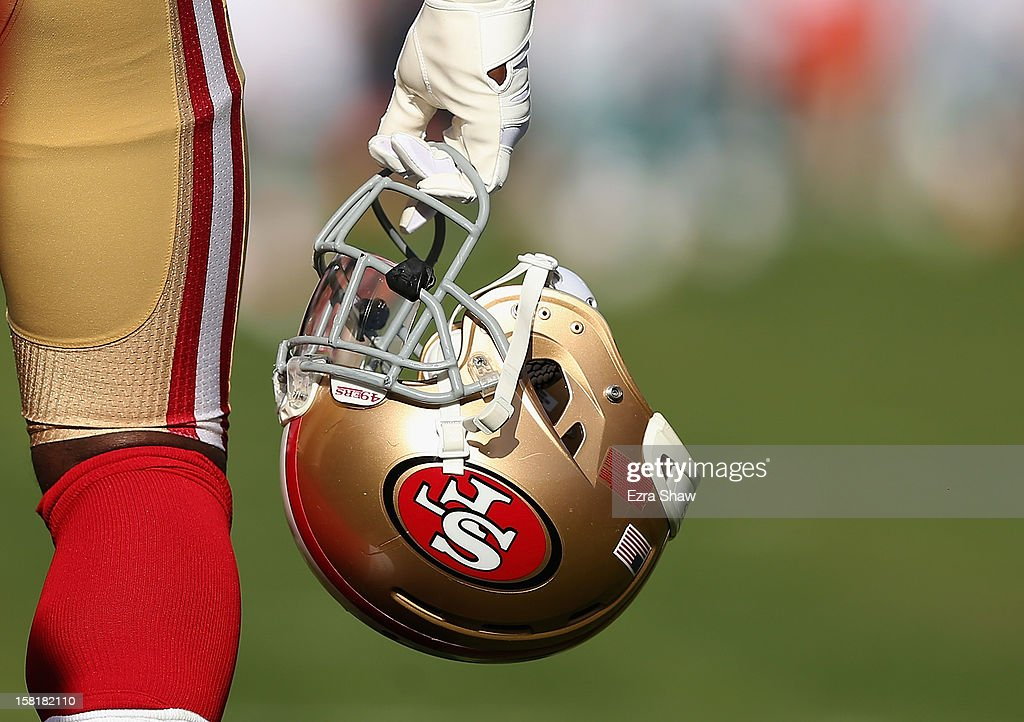 A San Francisco 49ers player carries his helmet before their game against the Miami Dolphins at Candlestick Park on December 9, 2012 in San Francisco, California.