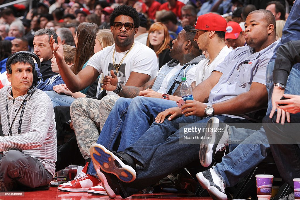 San Francisco 49ers players, from left, Michael Crabtree, Delanie Walker, Colin Kaepernick and Jonathan Goodwin attend a game between the Detroit Pistons and the Los Angeles Clippers at Staples Center on March 10, 2013 in Los Angeles, California.