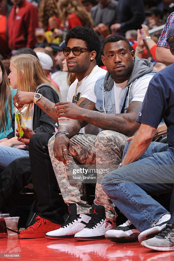 San Francisco 49ers players Michael Crabtree, left, and Delanie Walker attend a game between the Detroit Pistons and the Los Angeles Clippers at Staples Center on March 10, 2013 in Los Angeles, California.