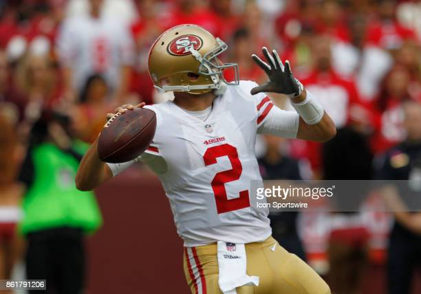 San Francisco 49ers quarterback Brian Hoyer cocks to fire a pass downfield from the pocket during a football game between the San Francisco 49ers and...